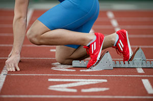 Runner on starting blocks