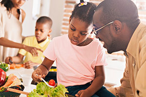 Parents teaching kids to eat healthy