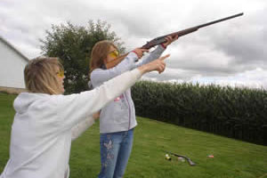 Parent showing teen how to shoot a gun