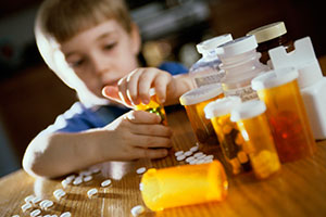 Child opening prescription pill bottles