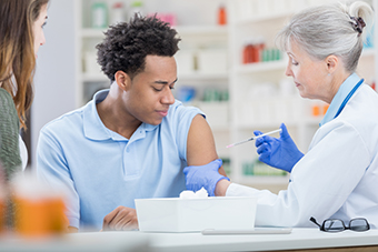 Teen boy getting vaccine