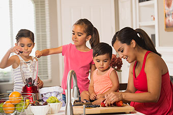 Mom preparing food with her children