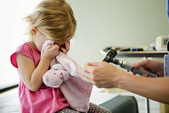 Little girl crying at the doctor's office