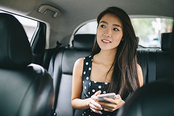 teen girl in back seat of car