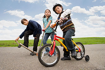 kids on bikes, skateboards, and scooters