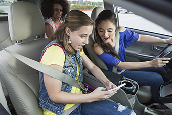 Teens in car distracted by phone