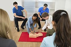 Teens learning CPR