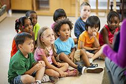 Preschool children listening to their teacher