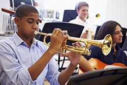 Student playing the trumpet in school band