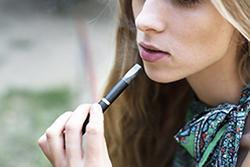 Teen girl with e-cigarette