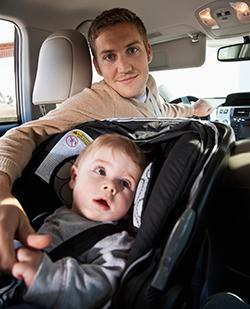 Baby in car seat with dad