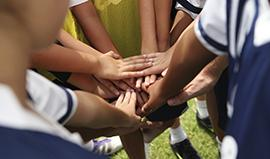 School sports team huddle