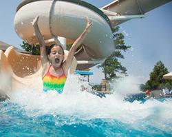 Girl going down water slide